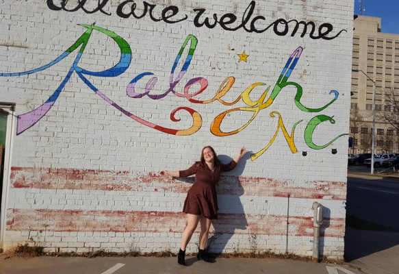 Jenna Travis welcomes people to Raleigh